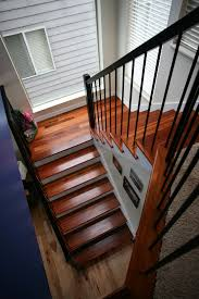contemporary stairs tiger wood treads wrought iron 6500 rail