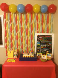 Curious George birthday party cake table