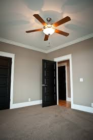 love the dark doors painted trim are your windows painted or stained