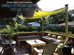 a lovely seating area with wooden deck backyard patio and yellow