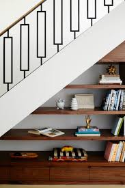 amazing metal stair rail and storage under the stairs designed by