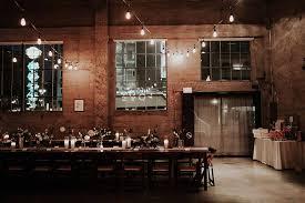industrial loft industrial loft wedding with a geometric ceremony backdrop ruffled