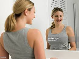 Bathroom Mirror Shots by Reflection Of Young Woman In Bathroom Mirror Stock Photo Getty