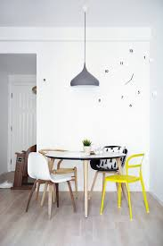 mixed dining chairs ideas dining room eclectic with wall clock