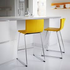 add color to a white kitchen and dining space with bright stools