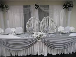 silver wedding decorations a simple high table and backdrop