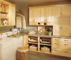 what colors go well with maple cabinets maple cabinets in a laundry room kemper