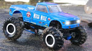 bigfoot presents meteor and the mighty monster trucks crazy blue monster truck and racing cars in the city kids