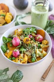 spring vegetable buddha bowls with avocado green goddess dressing