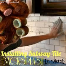 white subway tile backsplash with black cabinets hometalk