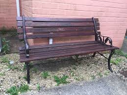 nice old cast iron and wood garden bench in swindon wiltshire