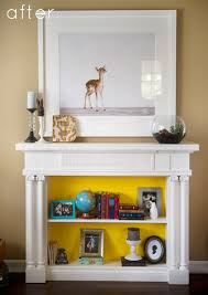 design sponge featured this bookshelf fireplace you can read about how the homeowners attached a vintage mantel to a bookshelf to create a faux fireplace