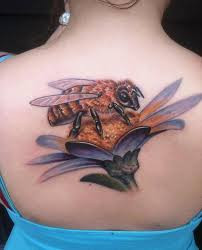 bees with beehive tattoo on feet