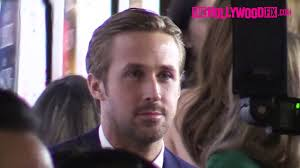 ryan gosling looks suave arriving to