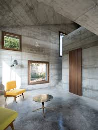 cuboid concrete holiday home rises in northern italy curbed