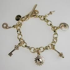 bespoke gold jewellery custom made gold charm bracelet bespoke gold charms london uk