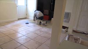 lapse of a 16 x16 ceramic tile installation on a basement
