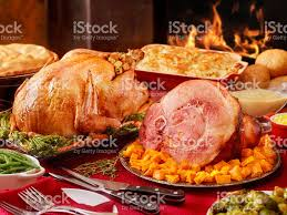 turkey and ham dinner with and all the fixings stock photo