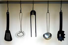 free stock photos of kitchen utensils pexels black plastic spatula hanged on black hook
