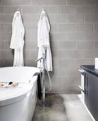 exposed concrete bathroom modern with tub wooden vanities tops