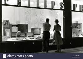 Tv In Front Of Window by Trade Shops Showcase Couple In Front Of An Electronic Shop