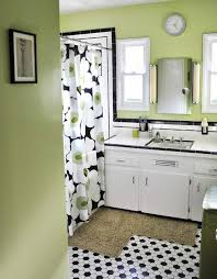 white bathroom with black floor black and white tile bathrooms