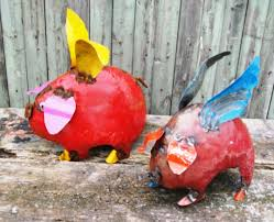 recycled metal sculpture flying pig