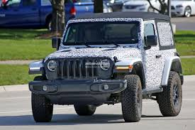 first jeep ever made spyshots 2018 jeep wrangler jl reveals grille and headlights