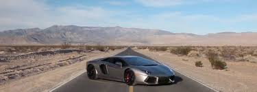 lamborghini aventador on the road road tripping to sema in a lamborghini aventador