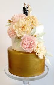 wedding cake gum wedding cake with brushed gold cascading gum paste peonies