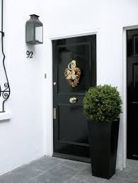 glossy black door traditional porch amory brown
