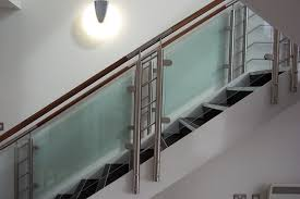 metal landing banister and railing glass staircase balustrade design with timber handrails glass