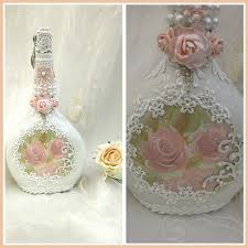shabby chic hand decorated wine bottle it has been painted with
