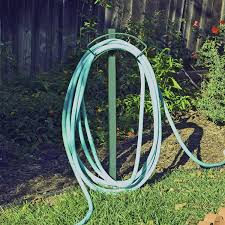 garden hose hanger with faucet home design ideas and pictures