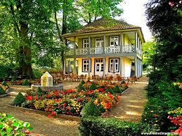 flower house with garden seat amongst the azalea flowers