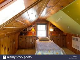 wood paneled attic bedroom with slanted ceiling single bed stock