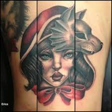another little red riding hood tattoo the person has the wolf on