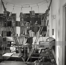 franco albini behind a bookcase pictures getty images the italian architect and designer franco albini posing behind a bookcase italy 1956