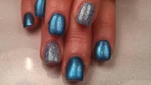 full set of gel nails using tips blue metallic and glitter