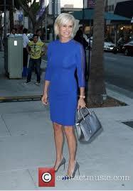 tolanda foster clothes yolanda foster s cobalt blue dress looks for less big blonde hair