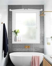 grey subway feature tiles around bathroom window bathroom ideas