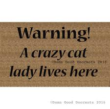 warning a crazy cat lady lives here funny doormat damn good