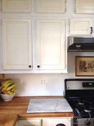 how to paint my kitchen cabinets white repainting my kitchen cabinets progress rizzo