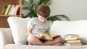 Little Boy Lying On Sofa With Book And Smiling Stock Footage Video - Lying sofa 2