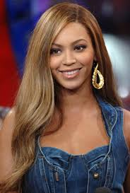 a side part with long hair and a swoop and a cross beyonce knowles long straight side part hair style hairstyles weekly