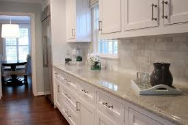 carrara marble subway tile kitchen backsplash kashmir white granite kitchen transitional with glass front