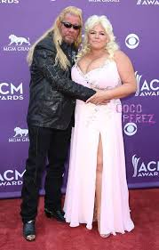 dog the bounty hunter s wife puts her bountiful bosoms on display at
