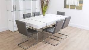 modern glass dining table quilted contemporary chunky white oak table glass legs quilted leather