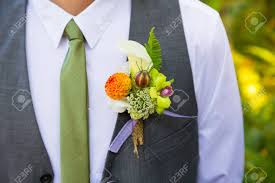 boutineer flowers a groom wearing a boutineer on his wedding day made from