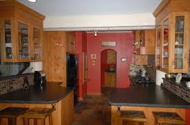 knotty alder cabinets with leathered black granite counters much